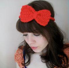Crochet headband with a large bow.