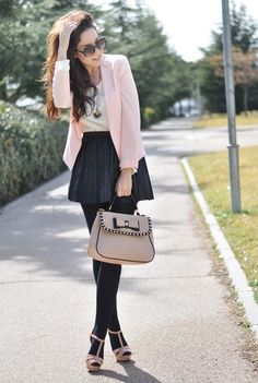 Pink blazer and black skirt
