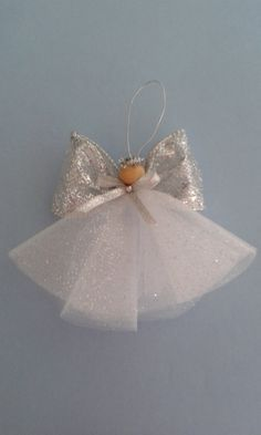 Gorgeous sparkling angel ornament, shes 5 tall and made with silver glittery ribbon and tulle.Angel ornament by bundlesandmore on EtsyAll 10 gift ideas are a breeze to make, ideal for beginners in crafts. Otherwise, it's still a fine gift idea but we Christmas Angel Ornaments, Easy Christmas Crafts, Christmas Art, Christmas Projects, Handmade Christmas, Christmas Decorations, Simple Christmas, Christmas Holidays, Diy Angels