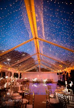 Another picture of the same tent. I DO NOT like the purple lighting but i love amber or gold lighting on the beams. We can light the dance floor intermittently with light blues to make the white dance floor look like water.