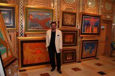 Juhani Palmu and his paintings.