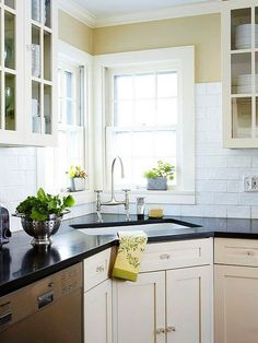 Love the corner sink. - Modern amenities mingle with classic farmhouse character in this updated kitchen. See how the homeowners created a functional space while staying true to their home's history. Corner Sink Kitchen, Kitchen Redo, New Kitchen, Kitchen Remodel, Updated Kitchen, Remodel Bathroom, Kitchen Ideas, Bathroom Faucets, Sinks