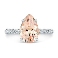 Pear morganite with a diamond shared prong band
