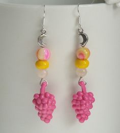 Dangle earrings made of a cute bunch of grapes, a moon charm and three beads between. The bunches are old...I have already had when I was a little