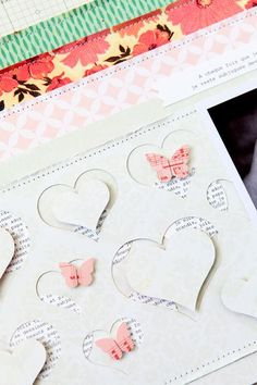 adapt for a layout - punched heart frames with text behind; butterfly accents