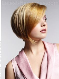 CLASSIC SOFT ROUNDED A LINE  A classic geometric round layered bob with a long side fringe.