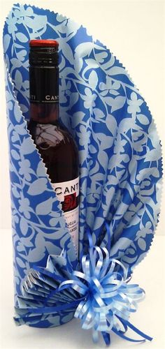 Wrapped In Style! - Gallery - Gift Wrapping  Japanese inspired gift wrapped bottle of wine.  Finished with a small fan and handmade bow.