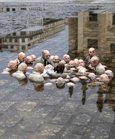 Follow the Leaders (Politicians discussing climate change) by Isaac Cordal