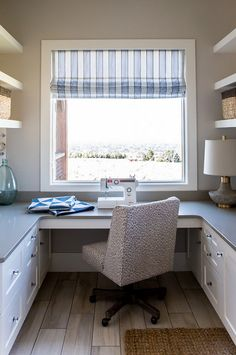The laundry room features a sewing space! Timber Frame Home with Farmhouse-Inspired Interiors