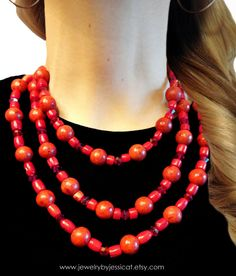 Authentic coral gemstones paired with splashes of red Swarovski crystals makes the absolute perfect combination!     GEMSTONE CORAL Statement Necklace Red Orange by JewelryByJessicaT,