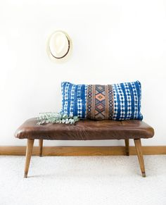 This gorgeous DIY leather tufted bench is the perfect complement to any living space, whether it's displayed in your entryway or at the foot of your bed. Cozy it up with a vibrant patterned pillow to balance out its retro feel with a contemporary flair.