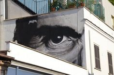 """A Roma, al Pigneto, Ostia e Torpignattara, la street art dedicata a Pasolini. Maupal   autore di """"L'occhio è l'unico che può accorgersi della bellezza"""" in via Fanfulla da Lodi"""