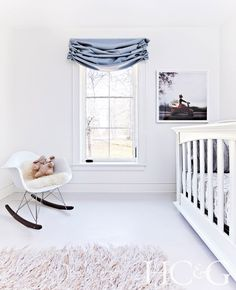 White child's room with crib and rocking chair