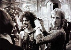 """Final touches on Tim Curry during """"Rocky Horror Picture Show"""" (1975)"""