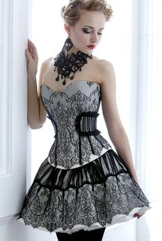 Image of a model showcasing a corset style vintage strapless dress
