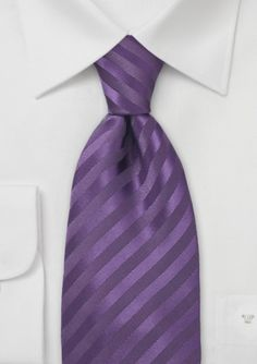 Mens Necktie in Lapis Purple  Puccini has designed this microfiber neck tie that is the epitome of elegance. Purchasing this tie is a wonderful and wise choice because there are not many like it. It is a unique piece that is recognized for its quality and intricate color and pattern.