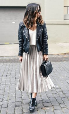a biker jacket that never goes out of style mixed with a pleated skirt which is definitely a good idea