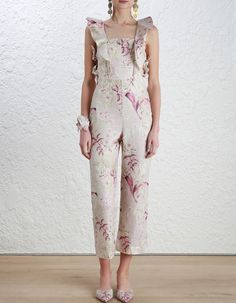 Zimmermann Winsome Apron Jumpsuit. Model Image.  Our model is 5 10 5 and is wearing a size 0