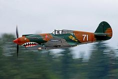 The P-40 Tomahawk debuted at the start of WWII and was a modification of the older P-36 Hawk. Because of this heritage, the plane was relatively easy to produce and could be hurried into service. Its low cost kept the aircraft in production as a ground attack fighter long after other airplanes had technologically surpassed it. The P-40 is particularly notable for being the shark-mouthed choice of the famed Flying Tiger squadron. While this fighter was manufactured in the United States, it…