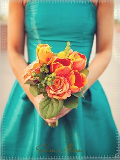 teal/turquoise dress with a firey orange bouquet