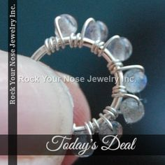 Today Only! $3 OFF this item.  Follow us on Pinterest to be the first to see our exciting Daily Deals. Today's Product: Sale -  Beaded Silver Nose Ring Wrapped with Labradorite Buy now: http://www.rockyournose.com/products/beaded-silver-nose-ring-wrapped-with-labradorite?utm_source=Pinterest&utm_medium=Orangetwig_Marketing&utm_campaign=Wrap%20Me