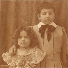 "People look at this Post-mortem photography from the Victorian period and see this little girl creeped out.  I see the love a family had for this little boy and how they wanted to remember him - alive and next to his sister.  This wasn't something ""creepy.""  It is a way of mourning the dead that has gone out of fashion because we have the ability now to take photos whenever we want. Pictures then took a long time to make--the little girl was probably just fidgety."