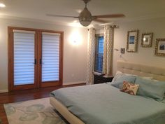 Hunter Douglas Vignettes on the french doors. Grey Faux Wood Blinds and white and blue drapes.  #dallas #windowtreatments www.traditionswindowdecor.com