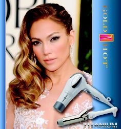"""Get the look! Part hair in a deep side part, and blow dry hair smooth. Using a large barreled curling iron (Suggestion: Gold 'N Hot Titanium 1-1/2"""" Titanium Curling Iron) curl hair in 1"""" sections. Be sure to curl hair all the same way. Allow hair to cool and then loosely comb through with fingers. pin back one side and pull all of the hair to the opposite side."""