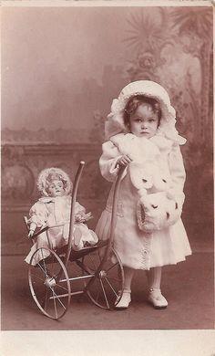 Winter girl with doll. 1900s. by Lauren Jaeger Mikalov, via Flickr