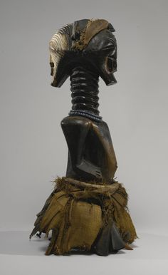 Songye Janus-Headed Power Statue of the name 'Mulange', Democratic Republic of the Congo | lot | Sotheby's