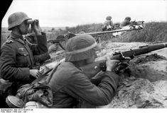 German soldiers in position.Notice the  soldier with the antitank gun, just behind the one with binoculars,  and on the background two machine -gunners with an MG 34. Russia near Woronesch, June 1942.