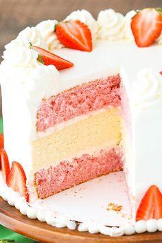 Strawberries and Cream Cheesecake Cake - strawberry cake, vanilla cheesecake and cream cheese whipped cream frosting! So good!