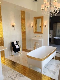 Accademia Gold #bathtub, Limited Edition of Autoritratti Collection in the wonderful showroom of @blackmanplumbin USA #design #bathroom