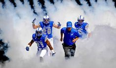 Air Force Academy football players and head coach Troy Calhoun run out onto the field for a game against Colgate Saturday in Air Force Academy, Colo. Football 2013, Falcons Football, Best Football Team, College Football, Football Players, Mountain West Conference, Air Force Academy, Contact Sport, Vince Lombardi