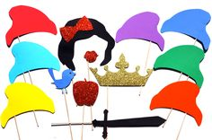 """This beautiful prop set includes Snow White and her seven friends!  What's included? ♥ 1 snow white hair with red GLITTER bow (approx. 8"""") ♥ 1 ruby red GLITTER lips (approx. 3"""") ♥ 7 Dwarf Hats (approx. 7"""") ♥ 1 Poison GLITTER apple (approx. 4"""") ♥ 1 Sword (approx. 6"""") ♥ 1 Blue Bird (approx...."""
