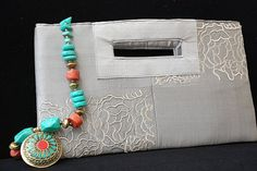 Embroidered and beaded clutch
