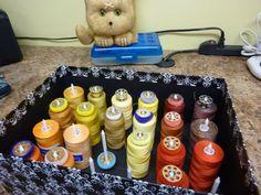 Thread Storage Idea from Quilting Board - hot glue XL golf tees in media storage box