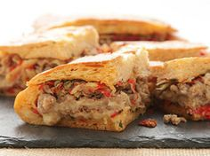 Italian Sausage and Fontina Shooter's-Style Sandwich With Onions, Peppers, Fennel, and Sun-Dried Tomato-Caper Relish   Serious Eats : Recipes