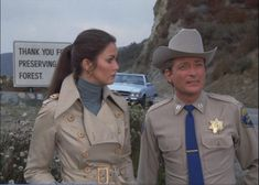 Trench Coat Spy Queen Lynda Carter looks quizzically at the law enforcement putz...