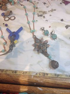 Fascinating pendant forming on Cynthia Peterson's work table.  Find her at Howling Dog Jewelry at Etsy.