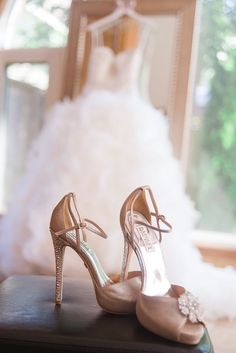 Shoes as the focus with the dress in the background photo ♥ For an easy-to-follow #Wedding #Photography #Guide ... https://itunes.apple.com/us/app/the-gold-wedding-planner/id498112599?ls=1=8 ♥ For more wedding inspiration ... http://pinterest.com/groomsandbrides/boards/ & magical wedding ideas.