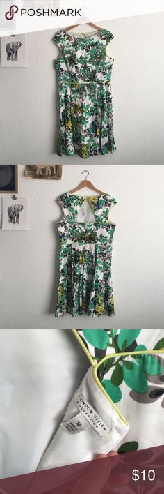 Gorgeous Green Floral Fit and Flare Dress London Style fit and flare cotton/spandex dress. Very gently worn, it does have two small stains on the back from storage. (Last picture, bottom left small brown stain, and near zipper, highlighter yellow stain. Might come out.) stunning keyhole back! Dresses Midi