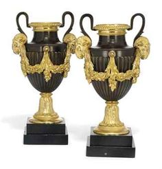 A PAIR OF FRENCH GILT AND PATINATED BRONZES URNS - Louis XVI Style