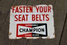 Vintage 1968 Enamel Champion Spark Plug FASTEN SEAT BELTS Sign