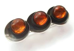 SOLD. Vintage N E From Danish modernist Baltic amber and sterling silver brooch, triple asymmetrical disc design, orange space age bar pin. https://www.etsy.com/listing/240926253/vintage-n-e-from-danish-modernist-baltic