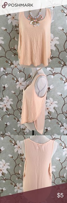 Forever 21 Pale Peach Layered Swing Tank Top Forever 21 pale peach layered swing, sleeveless top. Top is opaque, and features a flattering, flowy fit. Small pen mark on one of the layered flaps as shown in the last photo. I have not tried to remove it - though the top has been washed in a cold water, gentle cycle and hung to dry. Forever 21 Tops Tank Tops