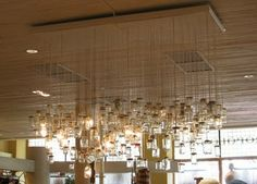 make installation with just empty glass jars intermixed with single hanging light bulbs for above kitchen table?