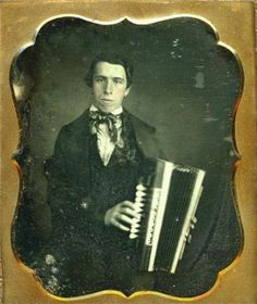 ca. 1850-60, [hand tinted daguerreotype portrait of a gentleman with his accordion] via Be-Hold Fine Photograhs
