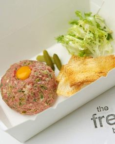 Takeaway: Steak tatare and a quail egg with French fries and salad from French Brasserie.