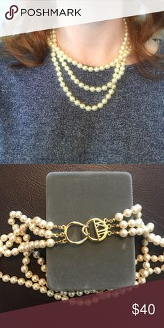 Faux Pearls A triple strand of faux pearls by Kenneth Jay Lane. His logo is on the clasp. Elegant and comfortable. All offers considered. Discounts offered on bundles. Kenneth Jay Lane Jewelry Necklaces